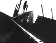 """From """"The Cabinet of Dr. Caligari"""" (1920), a significant film in German Expressionism. This is the famous rooftop abduction scene, in which a low-angle long shot enables us to absorb the full effect of the canted mise-en-scene."""