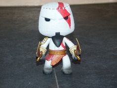 kratos sack boy figure. you cant get these here in the uk...but my Australian friends got him free with the ps3 edition of god of war 3. they sent me him...how lucky am i.