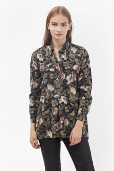 "<ul> <li> Soft-touch pull-over shirt in all-over camouflage and floral print</li> <li> Point collar with five-button placket</li> <li> Two button-fastened flap pockets</li> <li> Long cuffed sleeves</li> <li> Relaxed fit in longline length</li> <li> UK size 10 length is 74cm</li> </ul>  <strong>Our model is 5ft 9"" and is wearing a UK size 10. </strong>"