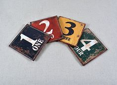 Decho Shabby Chic Look Colorful Numbers PU Leather Printed Set of 4 Coasters Decho http://www.amazon.com/dp/B00NLH929E/ref=cm_sw_r_pi_dp_IffQub1G60AWA  $8.99/set of 4 free shipping $35.96 for 4 sets.