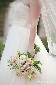 bridal bouquet of white anemone, sahara rose, white o'hara garden rose, white tulip, white ranunculus, blush astilbe, white stock, white delphinium, blush dahlia, light pink ranunculus, white scabiosa & variegated fern