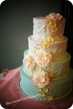 Spring-themed ombre cake with cascading flowers