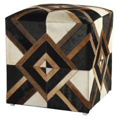 Authentic leather hair-on-hide decorates this pouf ottoman making it an ideal choice as an extra seat or a place to prop your feet. Hand stitched leather hide is mounted to a sturdy wood frame with a cushion top.