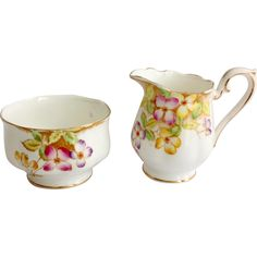 Lovely single Clematis flowers adorn this Royal Albert Bone China cream and sugar. Four-petaled flowers in shades of yellow, pink, and blue-violet