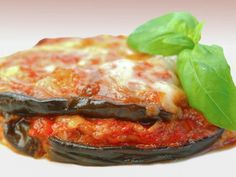 A 5-star recipe for Eggplant Parmesan made in the crock pot made with eggplants, bread crumbs, Parmesan cheese, marinara sauce, mozzarella cheese, fresh