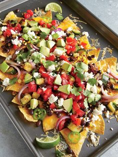 Two-Cheese Veggie Nachos. We love the double-cheese contrast here: Shredded cheese melts into a bubbly blanket over the tortillas, while crumbly queso fresco covers the veggies with a salty kick. It's an impressive dish for coffee table dining--it's fun to keep it all on the baking pan and serve as a shared platter.