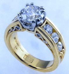 Ideal cut diamond set in custom designed engagement ring.