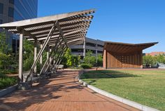 Built by Touloukian Touloukian Inc. in Greensboro, United States Shade Pergolas and an Outdoor Pavilion for performance and community gathering are designed for an urban park in Nort...