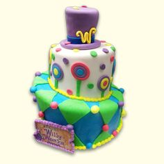 wonka cake - Google Search    i like this but think it would be fun to use actual lollipops, gumballs, candy buttons, etc and stick to mainly purple, red, yellow, and HOT PINK <3