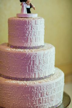 Wedding cake completely covered in Disney film quotes!
