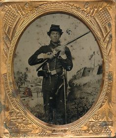 Sixth plate tintype of what is yank cavalryman armed with a rare Colt revolving rifle. This one was is posed before one of the Benton Barracks backdrop showing the fort on the hill. Images of Colt revolving rifles on their own are rare enough but this image is made even more rare by the uniform worn here. This is the uniform worn by the Fremont Body Guard who were commanded by major Zangoni. The unit was a hand selected cavalry regiment made up of men who exhibited high intelligence…
