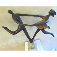Alfred Tibor Sculpture On Top of the World, Bonded Bronze. Available at Argo & Lehne Jewelers.