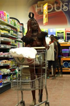 NAMIBIA: African tribeswoman making trip to the supermarket