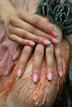 Create silver metallic French tips alongside a gradient pink polish to make your nails stand out more.