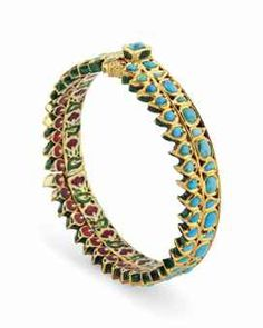 A TURQUOISE-INSET ENAMEL GOLD BRACELET INDIA, 19TH CENTURY The decoration arranged in a register of octagonal medallions interspersed with drop-shaped motifs below a register of mango-shaped patterns, each inset with turquoise stones, the reverse with repeating polychrome enamel floral spray.