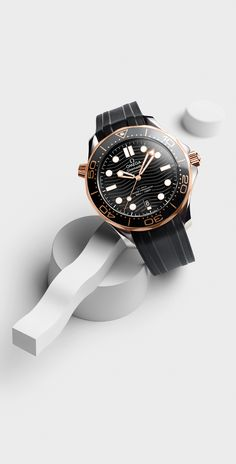 The OMEGA Seamaster Diver A divers' watch in stainless steel and Sedna™ gold with a black ceramic dial and black rubber strap. Omega Seamaster Deville, Omega Seamaster Diver 300m, Omega Watches Seamaster, Omega Seamaster Automatic, Omega Speedmaster, Seamaster 300, Best Watches For Men, Big Watches, Vintage Watches For Men
