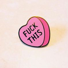 Sometimes love is the worst. When it is, feel free to let everyone know with this 1 inch hard enamel pin. It sports gold plated metal detailing and