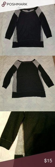 "American Eagle Outfitters  Sweater Size medium. 3 1/2"" slits on each side with a zipper open and closing on each side.  See picture. This shirt is just too cute... 3/4 length sleeves. Armpit to armpit 19 1/2"". Length top to bottom 26"". Good condition. No holes, tears, pulls. American Eagle Outfitters Tops Sweatshirts & Hoodies"