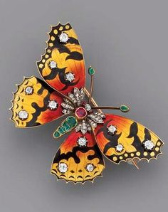 Circa 1880 butterfly brooch. The emerald body, ruby thorax, and diamond-set head with ruby eyes, to the yellow, red, and black basse-taille enamel wings with old-cut diamond detail, mounted in silver and gold, 5.7 cm. wide, with French assay marks for gold, in blue velvet fitted case.
