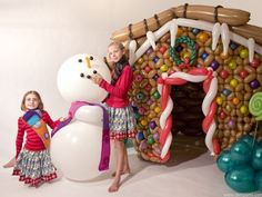 Life sized Gingerbread House made of balloons. And a cuddly snow man. :-) #christmas #balloons