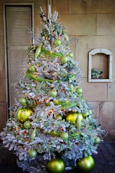 This tree is awesome! I want to start a green Christmas ornaments collection. Anything mixed-matched as long as it's mainly green.