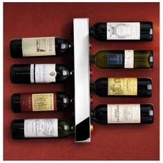 A Vertical Wine Rack Photo via www.lv When you lack horizontal space… go vertical! This wine rack is perfect for small apartments. It's modern and practical. A good example for space-saving products Nesting Bowls With [. Wine Bottle Rack, Wine Glass Rack, Bottle Wall, Wine Rack Wall, Wine Racks, Vitra Design Museum, Liquor Storage, Apartment Needs, Apartment Hacks