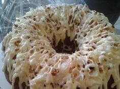 Italian Creme Bunt Cake-2 c all purpose flour 2 c sugar 1 stick butter 1/2 c shredded coconut 1 c finely chopped walnuts 5 egg whites  5 egg yolks 1 c buttermilk 1 1/2 tsp vanilla 1 tsp baking soda 1 Tbsp baking powder  CAKE ICING 8 oz cream cheese 1/2 c whipping cream 1/2 c chopped nuts 4 c powdered sugar 1/2 c coconut, shredded