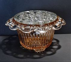 ITEM #RA-94 (Box R-2 )  Pink depression glass flower bowl with crystal frog in the Old Colony aka Lace Edge pattern by Hocking Glass Co circa 1935-38.  Bowl measures 7 across in diameter at widest point and stands 4 1/4 tall.  Condition: Very good vintage condition with typical wear due to age and handling. Both are chip free. The is a piece of dirt or something that ended up inside the class as shown in last photo, during the manufacturing process as I was unable to remove. Stating for ...