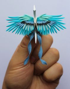 Elegant Paper Cranes Composed of Detailed Cuts, Folds, and Flowers – In paper artist Cristian Marianciuc (previously) started a goal to create a… Design Origami, Instruções Origami, Origami Mouse, Origami Star Box, Origami Dragon, Origami Fish, Origami Paper Art, Origami Folding, Oragami
