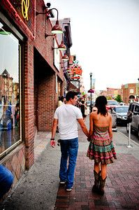 Cute couple's engagement photos taken on Broadway in Nashville