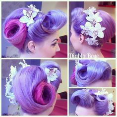 Today's hair; BIG swirly ness and victory rolls, with hair flowers from…