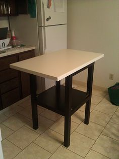 2 ikea side tables, painted & attached together, countertop- Thinking I could do this with 2 coffee tables to make a bigger kitchen island!