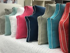 Already a Dorm Decor favorite this oversized pillow in the classic belgrave headboard shape is comfy and cozy. It works no matter how high you loft you bed. Available in beautiful colors with white piping. Add a monogram to personalize - $25 - hidden zipper closure - prima loft down alternative insert included