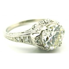 Edwardian era platinum & Old Cut diamond engagement ring with a pierced open work and filigree design feautring a 1.61 Carat Old European Cut diamond with smaller round cut diamond accent stonesPrice Upon Request