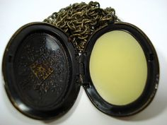 Solid Perfume Locket $16.00  I'd probably go for just the sticks, but I have metal sensitivities.
