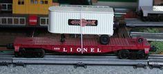 Lionel postwar # 6810 flatcar with a white Cooper-Jarrett trailer.