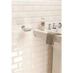 Metro style tiles are so on trend right now. Crisp and glossy white makes this a very modern look. To add extra interest, opt for a bevel style.