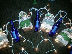 Lights I made for my outdoor fall wedding with budlight platinum bottles and mason jars!