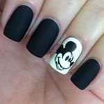 Black & White nails for the #31DC2013. I'm really proud of that #MickeyMouse. I was inspired by @robinmosesnailart to try using acrylic paints more. I watched a ton of her videos yesterday (my first time watching, what the heck?!) I love how simple and classic this is. The black is Sinful Colors 'Whipped' - gotta love a matte black polish all on its own. I do! #mickeymousenails Hopefully I'll start using acrylics on the regular!