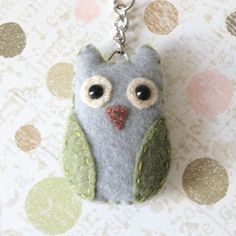 """Felt Owl Keychain~Grey & Green in Color BY CattaDolls @Etsy: $8.00. SOLD. This felt owl keychain is hand sewn using felt & stuffed w/ polyester fiberfill. Measures approx. 1"""" W X 2"""" H. This is handmade by me with love & care, thanks for looking! :)"""