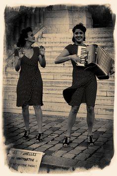 Les Jumelles de Montmartre - Enchanting girl duet also known as Les Jumelles de Montmartre, delighting the streets around La Basilique du Sacré Coeur, Paris, France.