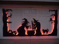 Halloween Garage Door Silhouette ~ wooden figures backlit with string lights | by mcorbin via Instructables.com