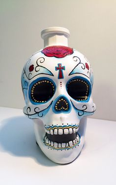 Add some character to any room with this hand painted bottle. This listing is for one, recycled and hand painted upcycled Crystal Head Vodka