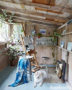 The wife, an amateur painter, turned a shed into her art studio. The floor is painted in Farrow & Ball's Light Blue.