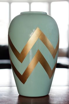 spray paint painters tape to make this chevron design on a vase!