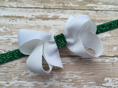 A personal favorite from my Etsy shop https://www.etsy.com/listing/255092123/white-boutique-bow-on-green-glitter
