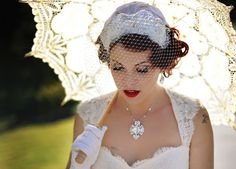 that's the look i'm going for... parasol, gloves, birdcage veil...