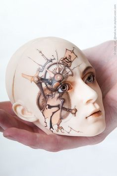 steampunked ball-jointed doll's head.- love the idea of painted doll shin but don't think i'm that skilled