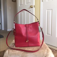 """Authentic Ralph Lauren Hobo Bag Authentic Ralph Lauren Hobo Bag. Style 431584904003 Crawley Hobo. Magnetic top closure with insert belt closure (see pictures). New with tag. Leather and Color- Red with gold hardware. Has No inside fabric lining, one inside pocket and a hang tag. Dimensions- 12"""" L x 11.5"""" H x 5"""" W and handle drop height of 9"""" & a removable long strap of 16"""" height. No dust bag available. Ralph Lauren Bags Hobos"""