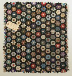 Patchwork. Silk. 1867. National Trust. Quilts are loaded with stories and personal expression. These geometric flowers aren't typical for a tattoo inspiration, but one or many could be interesting for nipple replacement or scar coverage. #mastectomy [p-ink.org]